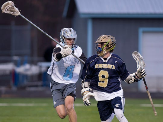 Essex's Grady Corkum, right, controls the ball ahead of the reach of South Burlington's Ben Capano purses Essex's Grady Corkum during a high school boys lacrosse game in 2018.