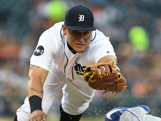 Tigers first baseman Miguel Cabrera dives to try to