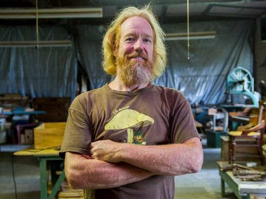 Richard Hess stands in the woodshop of his store, Waldenberg,