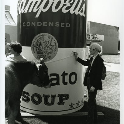 Andy Warhol signed the three soup cans during his visit