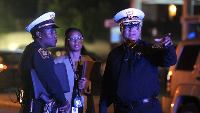 Cincinnati Police Chief Jeffrey Blackwell (right) visited the scene of Tuesday night's officer-involved shooting in Northside.