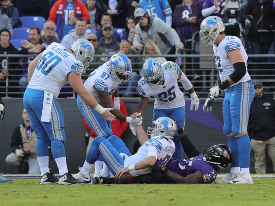 Lions quarterback Matthew Stafford gets helped up after being sacked by Ravens linebacker Terrell Suggs during the Lions' 44-20 loss on Sunday, Dec. 3, 2017, in Baltimore.