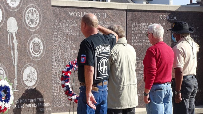 Wreaths were placed Saturday at the Franklin County Memorial Wall during a ceremony to honor local veterans.
