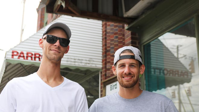 Grant Holcomb, left, stands in front of the Parrott building at 300 N. Herritage St. with his brother Zac on Thursday, Aug. 20.