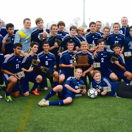 The 2013 soccer state champs of Urbana High School.