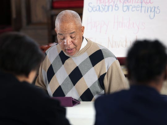 Deacon Robert Mitchell led a Bible-study group in its