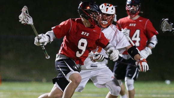 Rye's Billy Chabot  (9) breaks for the goal against Mamaroneck during lacrosse action at Mamaroneck High School April 14, 2018. Rye won the game 12-5.