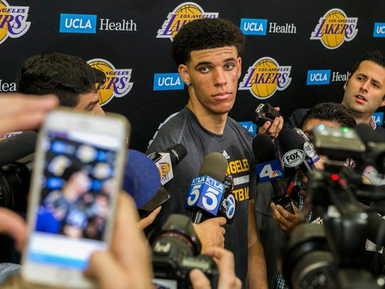 UCLA guard Lonzo Ball takes questions from the media after a closed Los Angeles Lakes pre-draft workout in El Segundo, Calif.