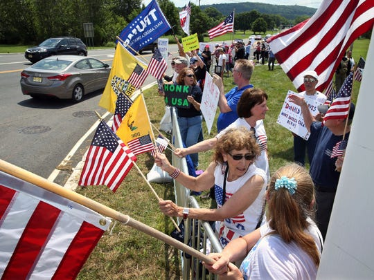 An anti-Trump protest took place about a mile away from the U.S. Women's Open at President Donald Trump's golf course in Bedminster on Saturday.
