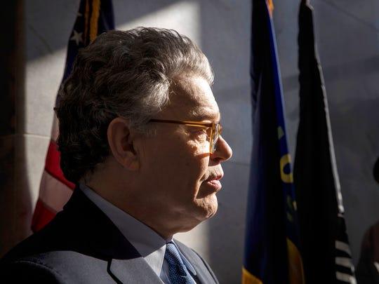 Sen. Al Franken, D-Minn., talks to the media on Capitol Hill in Washington, Monday, Nov. 27.