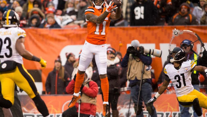 Cleveland Browns wide receiver Terrelle Pryor (11) makes a first down reception against the Pittsburgh Steelers during the third quarter at FirstEnergy Stadium. The Steelers won 24-9. Mandatory Credit: Scott R. Galvin-USA TODAY Sports