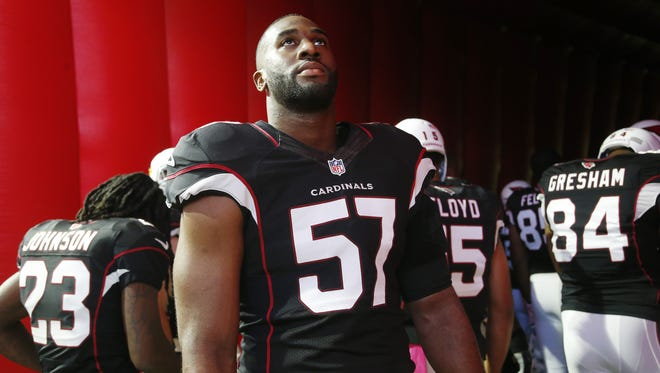 If Arizona Cardinals LB Alex Okafor (57) chose to have surgery, it might've meant missing the entire season.
