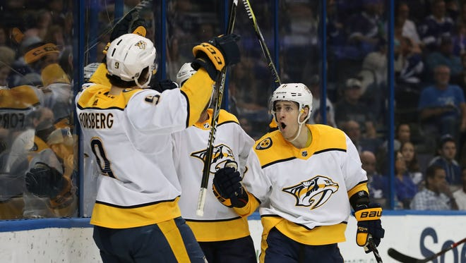 Apr 1, 2018; Tampa, FL, USA; Nashville Predators left wing Filip Forsberg (9) is congratulated by center Kyle Turris (8) and teammates as he scores a goal against the Tampa Bay Lightning during the second period at Amalie Arena. Mandatory Credit: Kim Klement-USA TODAY Sports