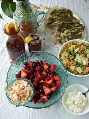Grilled tilapia, green bean pasta salad, peachy iced tea and ruby red fruit salad add up to a flavorful, simple summer meal.