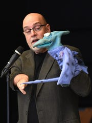 Puppeteer Richard Paul gave a Jan. 9 presentation at Northville's Silver Springs Elementary on diversity, acceptance and Dr. Martin Luther King Jr. The pterodactyl in his hands was introduced to show the school's students that accepting people that look or act different than they do is an honorable thing.