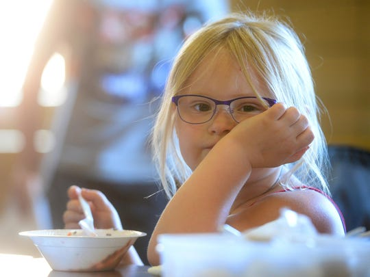 Kylie Jambretz, age 4, enjoys ice cream during the Lincoln Elementary School Ice Cream Social and Book Fair.