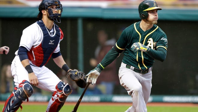 Oakland Athletics' Josh Reddick watches his grand slam off Cleveland Indians starting pitcher Zach McAllister in the second inning.