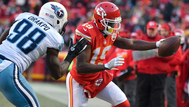FILE - In this Dec. 18, 2016, file photo, Kansas City Chiefs wide receiver Jeremy Maclin (19) reaches for a first down next to Tennessee Titans linebacker Brian Orakpo (98) during an NFL football game in Kansas City, Mo. The Chiefs released Maclin in a stunning move Friday, June 2, midway through their voluntary workouts, bringing an abrupt ending to the tenure of what was arguably general manager John Dorsey and coach Andy Reid's biggest free-agent acquisition.