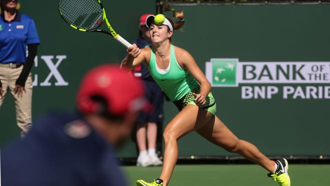 American Catherine Bellis, chases down a ball from Kirsten Flipkens, of Belgium, in Stadium 1 during the first Wednesday of the BNP Paribas Open on Wednesday, March 8, 2017 in Indian Wells, CA.