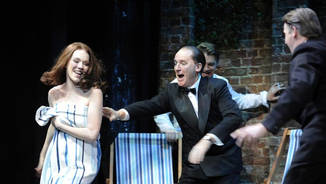 Charlotte Spencer (Christine Keeler) and Daniel Flynn (John Profumo) perform in 'Stephen Ward' at London's Aldwych Theatre.