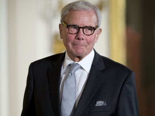 Tom Brokaw is pictured as receives the Presidential