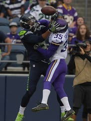 Seattle Seahawks wide receiver Kasen Williams is defended