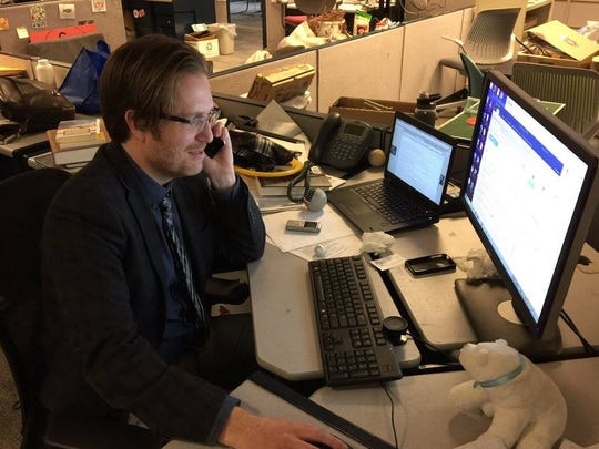 Scott Wartman completes a breaking news story at the Cincinnati Enquirer newsroom.