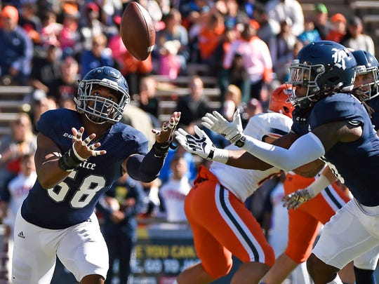 Rice linebacker Emmanuel Ellerbee, left, and safety Destri White try to catch a deflected pass during the first half of an NCAA college football game against UTEP, Saturday, Nov. 19, 2016, in Houston.