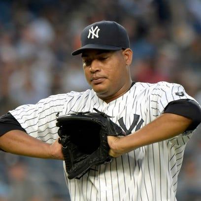 New York Yankees pitcher Ivan Nova reacts as he leaves