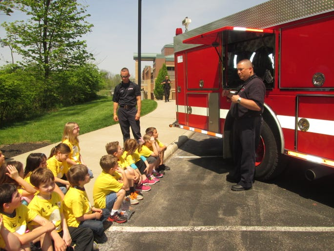 Firefighter-Paramedic Bill Storm of Anderson Township Fire and Rescue shares information about fire trucks with students.
