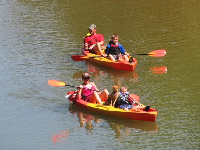 Members of the Damon Slaughter family of Liberty float in their kayaks.