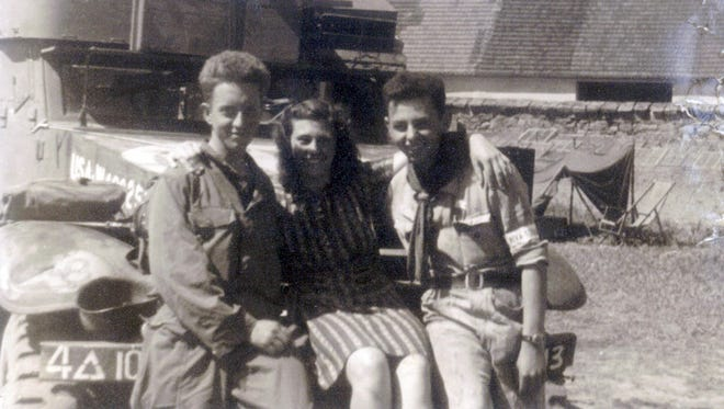 American GI Paul Huffman (left) poses with two locals in the Czechoslovakia city of Blatna at the end of World War II in Europe in 1945. For years, Huffman and his family wondered about the identity of the young woman next to him, and now finally Paul's son, Jerry, has learned she is Blazena Hrabetova, who is alive and well and 92 years old.