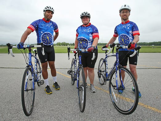 Special Olympics athletes (from left) Jerry Moore, Sarah Kaiser-Gunn and Zack Gunn during cycling practice outside of Hamilton Heights Primary School, Wednesday, June 4, 2014, in Arcadia. The trio are heading to Terre Haute this weekend for the state competition and next weekend going to Princeton, NJ, for nationals.