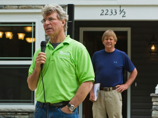Steve Thomas, former host of This Old House speaks during a celebration of the 30th anniversary of Habitat for Humanity of Lafayette as Doug Taylor, right, of Habitat Lafayette listens Tuesday, June10, 2014, at a home built for Habitat's Builder Blitz 2014. The home at Charles St. in Lafayette was built in about 12 hours.
