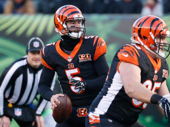 Cincinnati Bengals quarterback AJ McCarron looks to pass in the second half of an NFL football game against the Chicago Bears, Sunday, Dec. 10, 2017, in Cincinnati. McCarron signed a free-agent contract with the Buffalo Bills earlier this month.