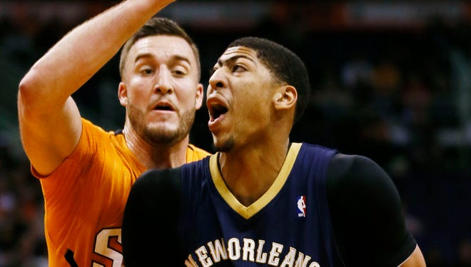 Feb. 28, 2014 - Pelicans' Anthony Davis is guarded by Suns' Miles Plumlee.