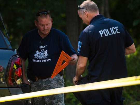 John Leahy (left), chief detective for Lebanon County, along with Cornwall Borough Police, Lebanon County Detectives and the Lebanon County District Attorney's office investigate a murder-attempted suicide outside of the Jigger Shop in Mt. Gretna Borough on Monday, Sept. 7, 2015.  The North Cornwall supervisors have named Leahy the township's new police chief. He starts his new job on Jan. 4, 2016.