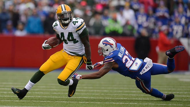 Green Bay Packers running back James Starks carries the ball against the Buffalo Bills during Sunday's game at Ralph Wilson Stadium in Orchard Park, N.Y.
