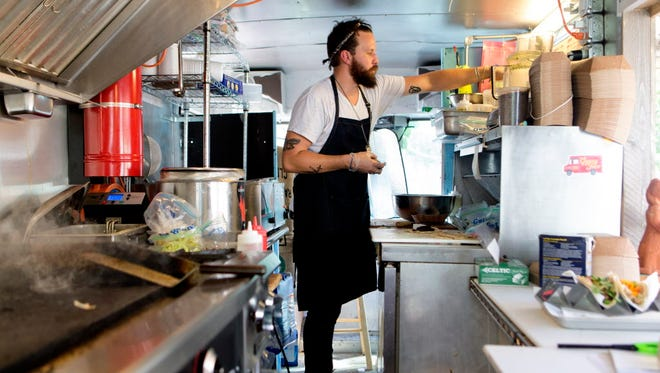 Chef-owner Mitch Ciohon, shown in summer 2016 preparing tacos in his Gypsy Taco food truck, parked permanently behind Boone & Crockett on the bar's patio, 2151 S. Kinnickinnic Ave. in Milwaukee.