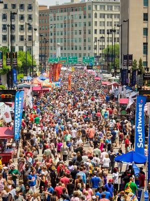 Thousands attend Taste of Cincinnati on Fifth Street in downtown Cincinnati Saturday, May 27, 2017.