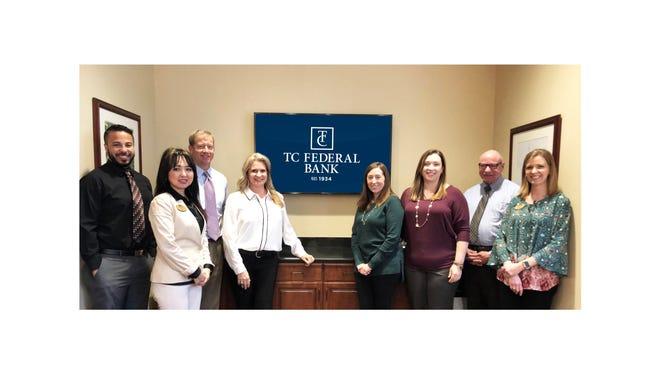 TC Federal Bank employees at Tallahassee office, from left to right. Dustin Baker, Ainura Mahorner, Nat Higdon, Penny Poole Harris, Megan Hance, Jessica Tryon, Matt Brown, Linda Bergman.