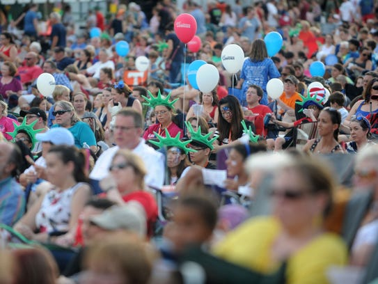 Attendees of Festival on the Fourth wait for the Knoxville