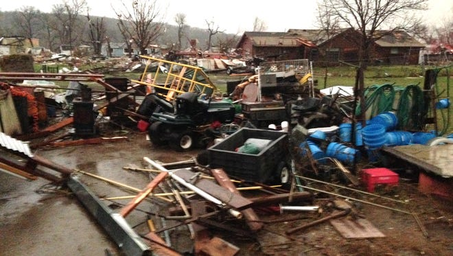 Debris litters the area west of Tulsa, Okla., after a tornado swept through the area March 25, 2015. One person died when the twister hit a mobile home park in Sand Springs.