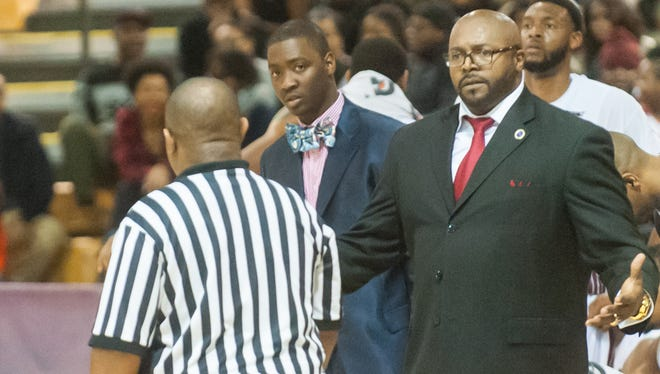 Trevor Deloach (blue suit) stands behind head coach Bobby Collins who argues a call during a 2015 game against Delaware State. Deloach coached two seasons at UMES and will continue his coaching career at South Carolina State.