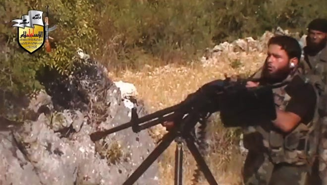Syrian rebel forces fight in August.