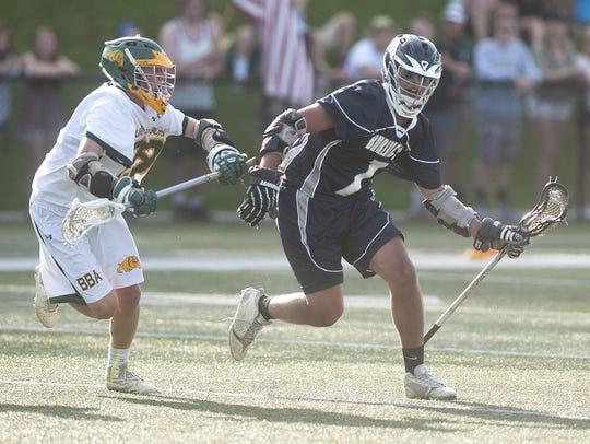Burlington's Sevin Gulfield, right, controls the ball