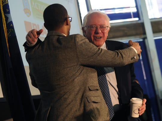 Democratic candidate for President Sen. Bernie Sanders gets a hug during the Real Solutions for Real People Summit at the Jot Travis building on the campus of the University of Nevada in Reno on Feb. 13, 2016.