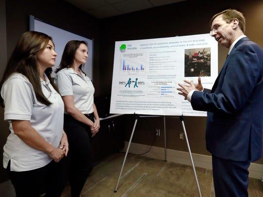 Dr. David Jernigan talks with Sophia Ornelas, left,