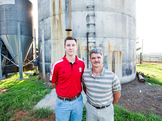 In this June 15, 2017 photo, Jonah Sykes, left, and his father, Jeff Sykes, stand for a portrait on their dairy farm in Mebane, N.C. Jonah Sykes grew up on his father's farm on Vernon Road and has decided to spend his life on that farm, to take it over and run it after his father retires.