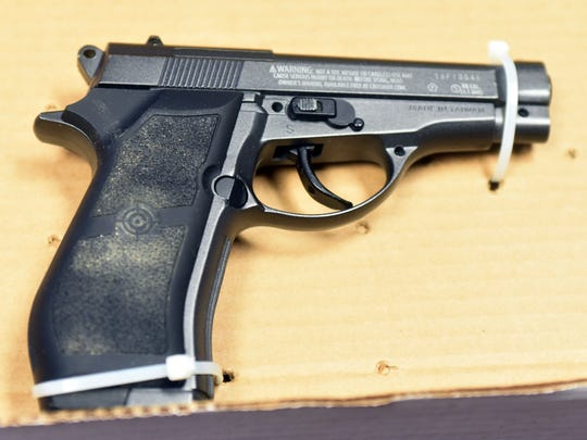 """The """"gun"""" that was taken off of Joel Asaiha Hampsire is shown at the press conference. It is a Crossman air gun."""